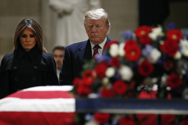 President Donald Trump and first lady Melania Trump pay their respects to former President George H. W. Bush, as he lies in state in the Rotunda of the U.S. Capitol, Monday, Dec. 3, 2018, in Washington. (Jacquelyn Martin/AP)