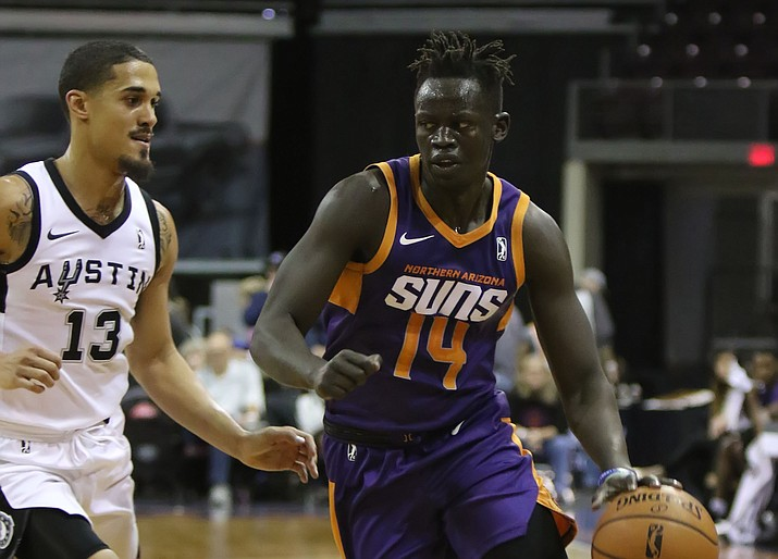 Peter Jok (14) drives to the basket in the first half against Austin on Tuesday, Dec. 4, 2018, in Prescott Valley. The Northern Arizona Suns lost 113-105. (Matt Hinshaw/NAZ Suns)