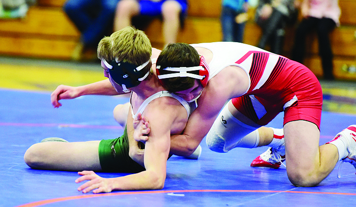 Bradshaw Mountain's Titus King wrestles Flagstaff's Spencer Johnson as they wrestled against Flagstaff and Chino Valley Wednesday, Dec. 5, 2018 in Chino Valley. (Les Stukenberg/Courier)