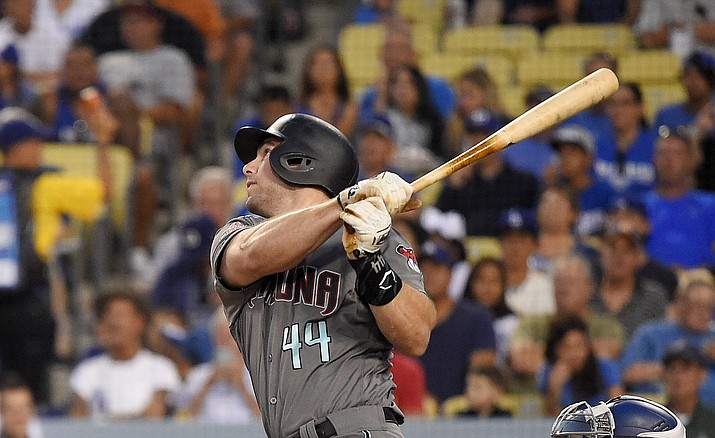 In this Aug. 31, 2018 file photo Arizona Diamondbacks' Paul Goldschmidt hits a two-run home run during the first inning of a baseball game against the Los Angeles Dodgers in Los Angeles. The St. Louis Cardinals have acquired Goldschmidt from the Diamondbacks in a multiplayer trade. The Cardinals sent pitcher Luke Weaver, catcher Carson Kelly, minor league infielder Andy Young and a 2019 draft pick to Arizona in the deal Wednesday, Dec. 5, 2018. (Mark J. Terrill/AP)