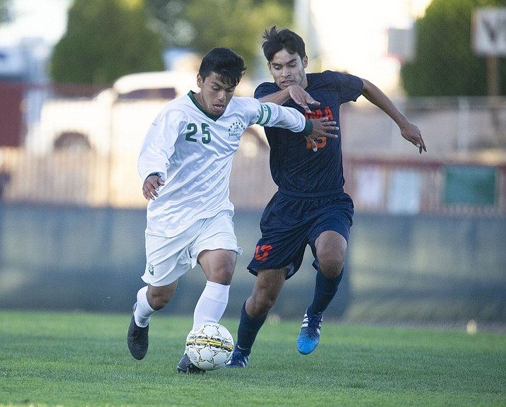 Yavapai's Jose Perez Flores (25) drives the ball upfield as the Roughriders take on the Pima Community College Aztecs Thursday, Sept. 20, 2018 at Ken Lindley Field in Prescott.(Les Stukenberg/Courier)