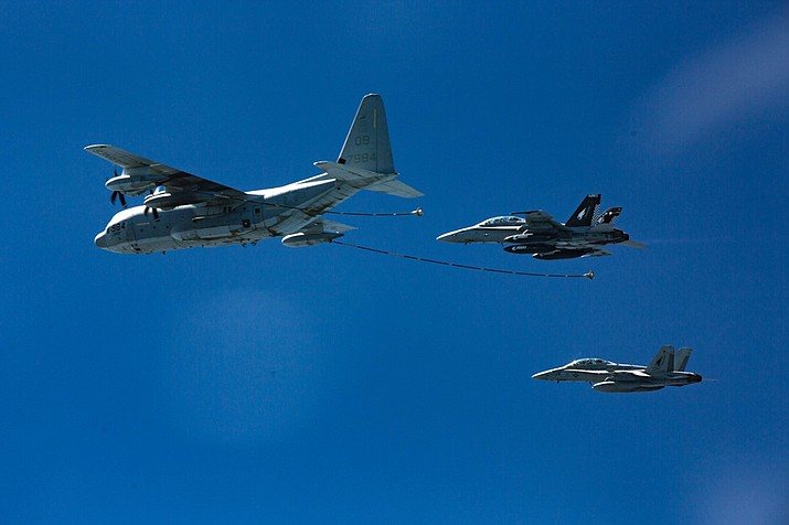 In this Oct. 13, 2016, photo provided by U.S. Marine Corps, two F/A-18D Hornets with Marine All-Weather Fighter Attack Squadron 533 approach a KC-130J with Marine Aerial Refueler Transport Squadron 352 during a Special Purpose Marine Air-Ground Task Force - Crisis Response - Central Command aerial refueling exercise in undisclosed location.  (Cpl. Trever Statz/U.S. Marine Corps via AP)