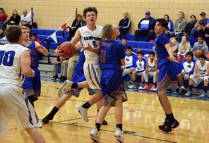Camp Verde junior Jordan Littlefield draws a foul during the Cowboys' 62-53 win over Chino Valley at home on Wednesday night. Littlefield scored six points, three rebounds, three assists and two steals. VVN/James Kelley