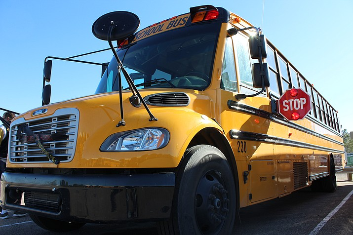 Gov. Doug Ducey announced that Kingman Unified School District is going to receive 10 new buses for its fleet without cost to the district. One stipulation was for buses with more than 100,000 miles to be replaced. (Photo by Vanessa Espinoza/Daily Miner)