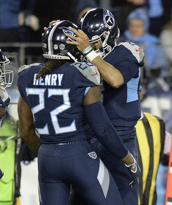 Tennessee Titans running back Derrick Henry (22) celebrates his touchdown with Tennessee Titans quarterback Marcus Mariota (8) during the second half of an NFL football game against the Jacksonville Jaguars, Thursday, Dec. 6, 2018, in Nashville, Tenn. (Mark Zaleski/AP)