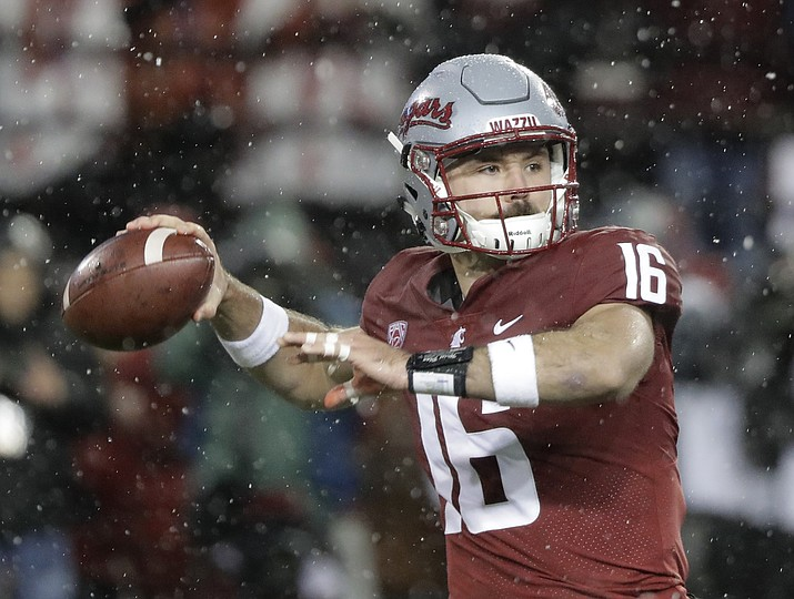 In this Nov. 23, 2018, file photo, Washington State quarterback Gardner Minshew passes against Washington during the first half of an NCAA college football game in Pullman, Wash. Minshew was named the Pac-12 offensive player of the year and the newcomer of the year Thursday, Dec. 6, 2018. (Ted S. Warren/AP, File)