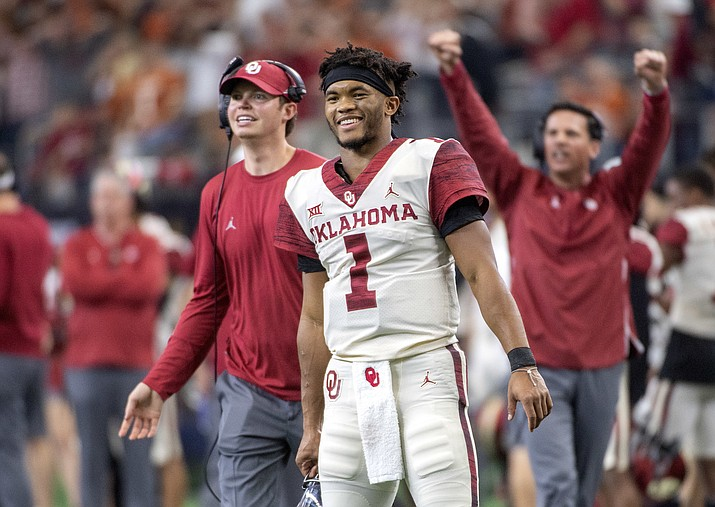In this Dec. 1, 2018, file photo, Oklahoma quarterback Kyler Murray (1) celebrates on the sidelines after throwing a touchdown against Oklahoma during the second half of the Big 12 Conference championship NCAA college football game, in Arlington, Texas. Murray was named The Associated Press college football Player of the Year, Thursday, Dec. 6, 2018. (Jeffrey McWhorter/AP File)