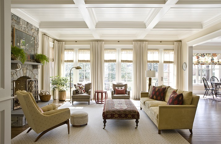 This photo provided by Marika Meyer Interiors shows a living room in McLean, Va. As 2019 approaches, Washington D.C.-based interior designer Marika Meyer sees a trend toward warm neutral colors and antique furniture in warm wood tones, as seen in this living room designed by Meyer. (Angie Seckinger/Marika Meyer Interiors via AP)