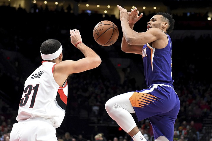 Portland Trail Blazers guard Seth Curry, left, knocks the ball away from Phoenix Suns guard Elie Okobo, right, during the first half of an NBA basketball in Portland, Ore., Thursday, Dec. 6, 2018. (Steve Dykes/AP)