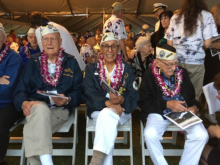 Tom Berg, left, of Port Townsend, Wash., Robert Fernandez, center, of Stockton, Calif., and George Keene of Newhall, Calif., all survivors of the 1941 Japanese attack on Pearl Harbor, take part in the 77th anniversary ceremony Friday, Dec. 7, 2018, at Pearl Harbor, Hawaii. (AP Photo/Audrey McAvoy)