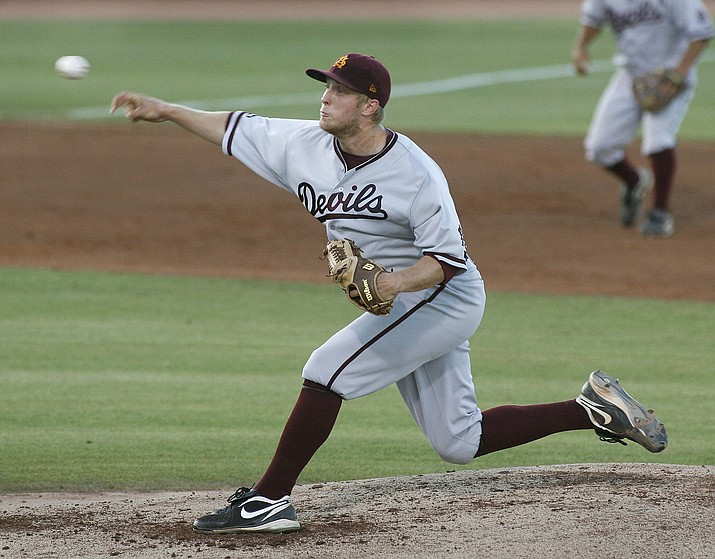 Arizona State's Merrill Kelly delivers a pitch against Arkansas during the first inning in an NCAA Tempe super regional college baseball game Sunday, June, 13, 2010 in Tempe. (Ralph Freso/AP, file)