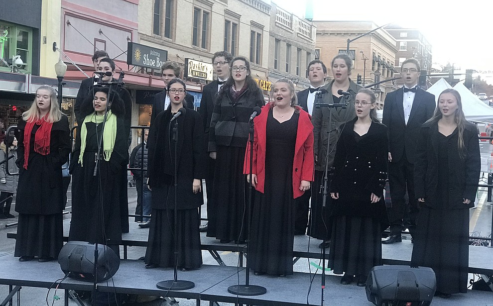The Prescott High Chamber Singers perform on Gurley Street during the 30th Annual Acker Musical Showcase Friday, Dec. 7, 2018 in downtown Prescott.  (Les Stukenberg/Courier).
