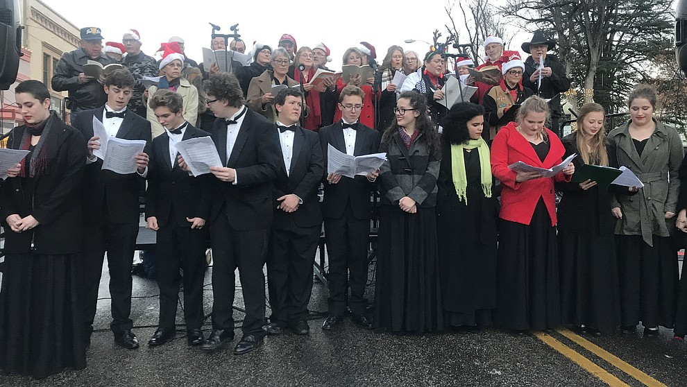 Community members sing the Hallelujah Chorus during opening ceremonies at the 30th Annual Acker Musical Showcase Friday, Dec. 7, 2018 in downtown Prescott.  (Les Stukenberg/Courier).