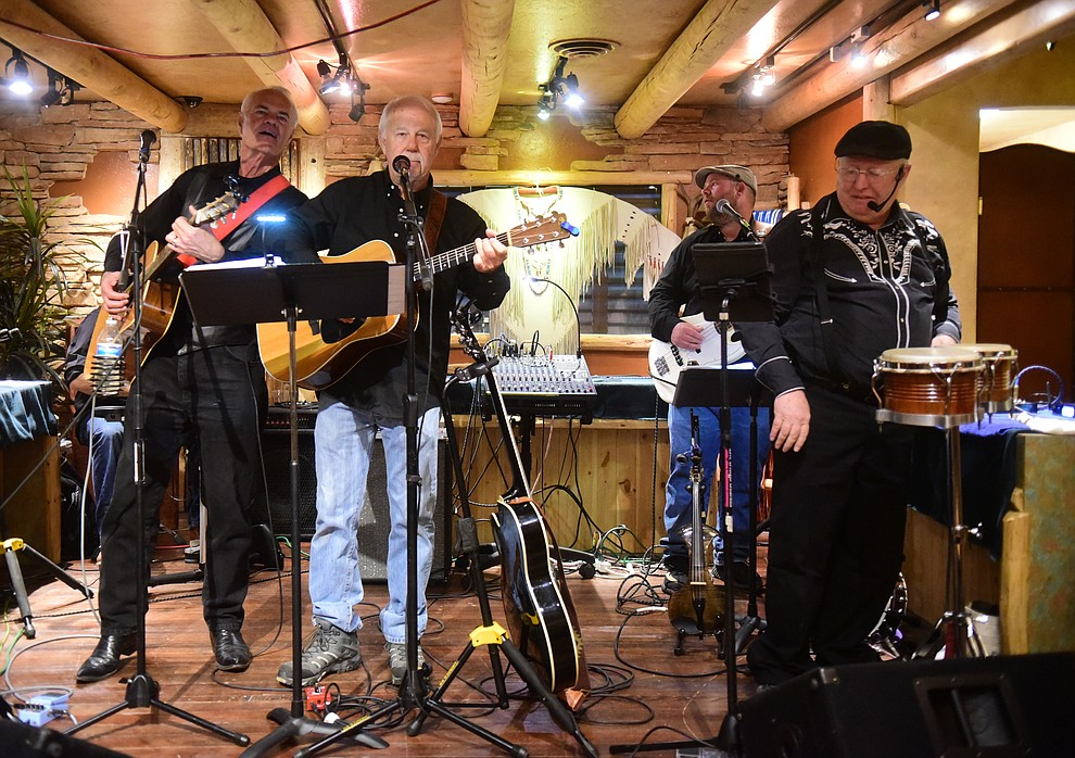 The Cool Water Band perform at Black Arrow Jewelry and Art during the 30th Annual Acker Musical Showcase Friday, Dec. 7, 2018 in downtown Prescott.  (Les Stukenberg/Courier).