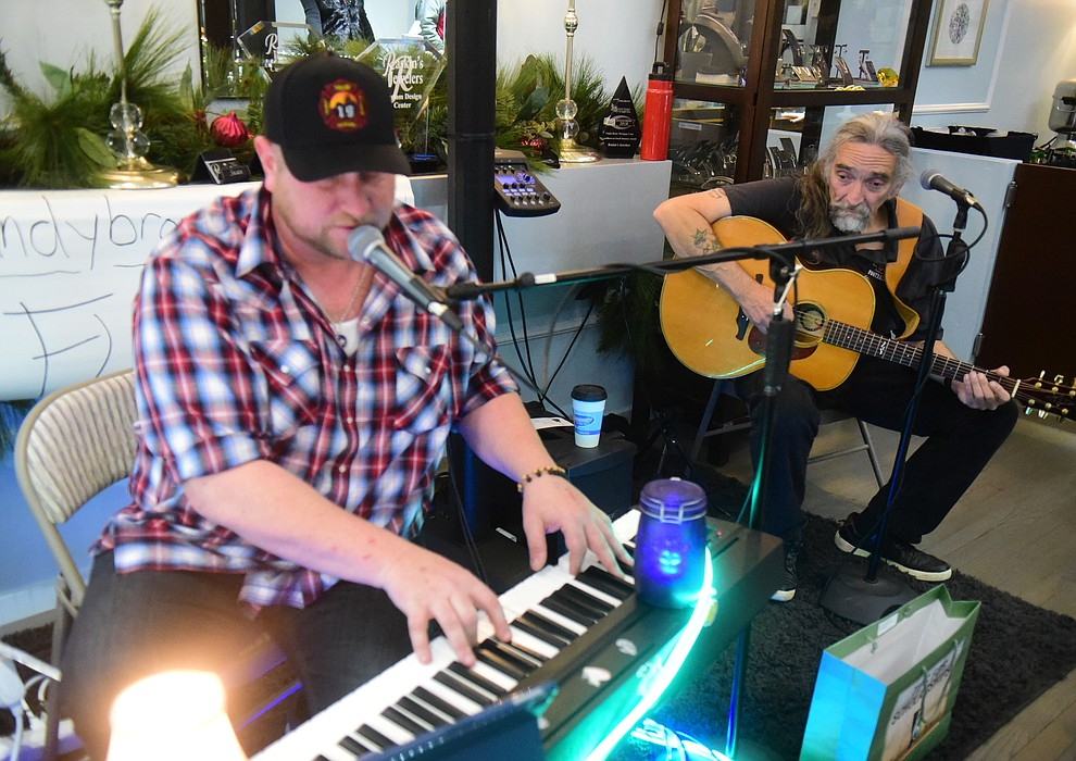 Floating Heartz  perform at  Raskins Jewelers during the 30th Annual Acker Musical Showcase Friday, Dec. 7, 2018 in downtown Prescott.  (Les Stukenberg/Courier).