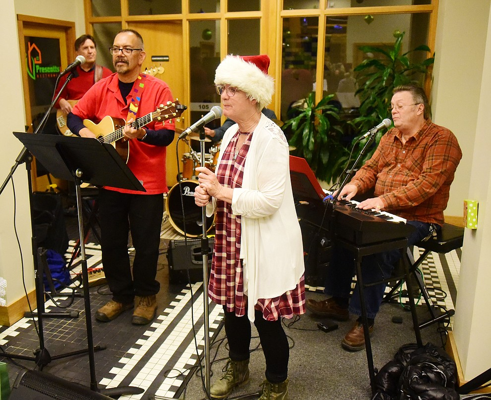 Adam and Friends  perform during the 30th Annual Acker Musical Showcase Friday, Dec. 7, 2018 in downtown Prescott.  (Les Stukenberg/Courier).