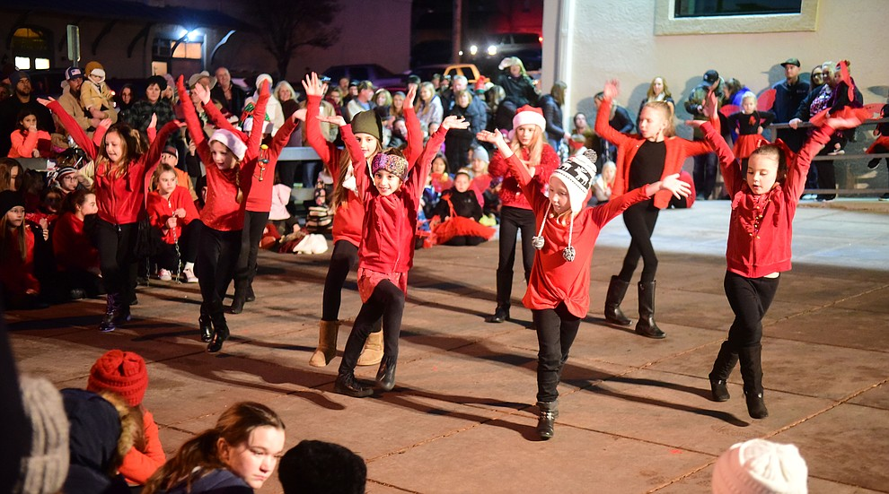 The Dance Studio perform in the Country Bank parking lot during the 30th Annual Acker Musical Showcase Friday, Dec. 7, 2018 in downtown Prescott.  (Les Stukenberg/Courier).