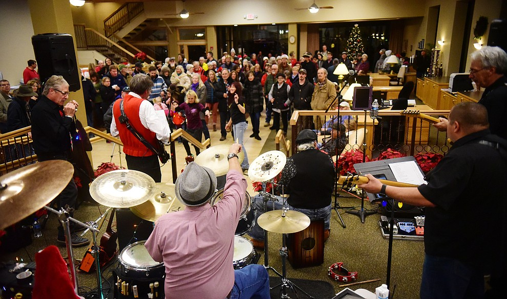 A large crowd watches as Road 1 South performs at Country Bank during the 30th Annual Acker Musical Showcase Friday, Dec. 7, 2018 in downtown Prescott.  (Les Stukenberg/Courier).