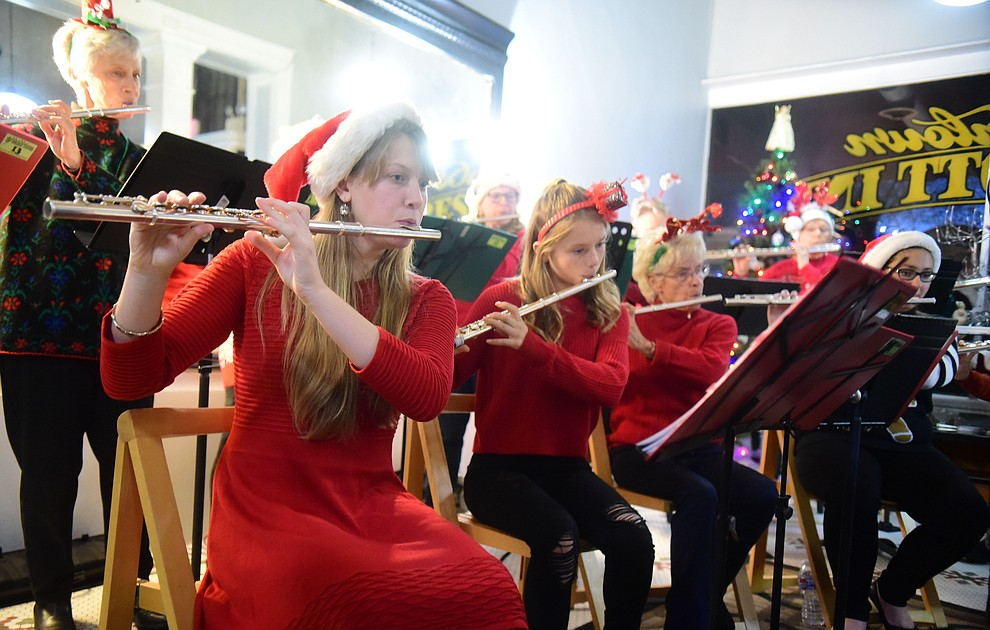 Holiday Fluties perform at the Downtown Prescott Inn during the 30th Annual Acker Musical Showcase Friday, Dec. 7, 2018 in downtown Prescott.  (Les Stukenberg/Courier).