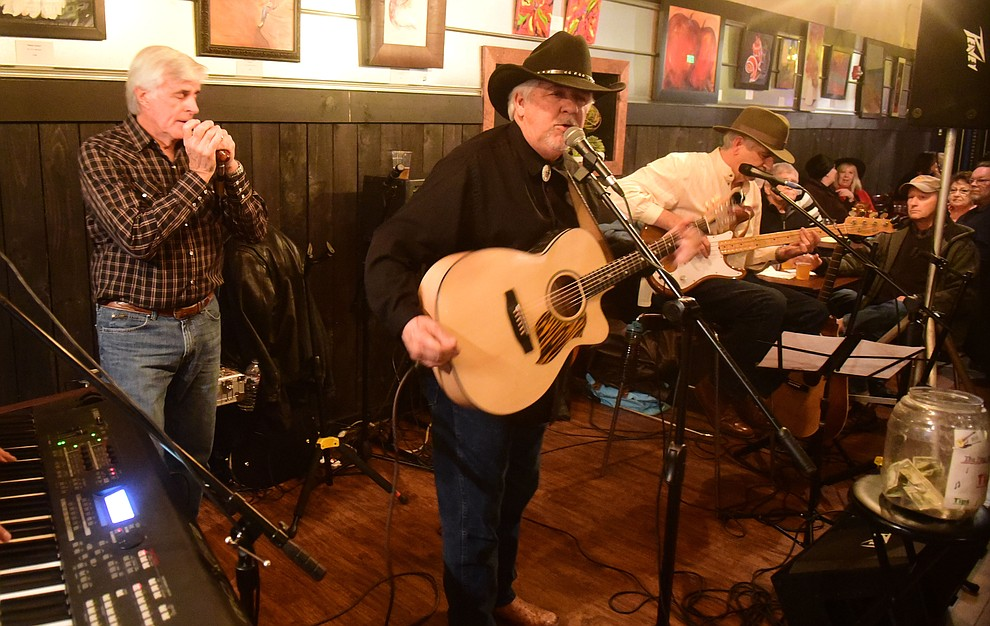 The Ping Brothers perform at Granite Mountain Brewing during the 30th Annual Acker Musical Showcase Friday, Dec. 7, 2018 in downtown Prescott.  (Les Stukenberg/Courier).