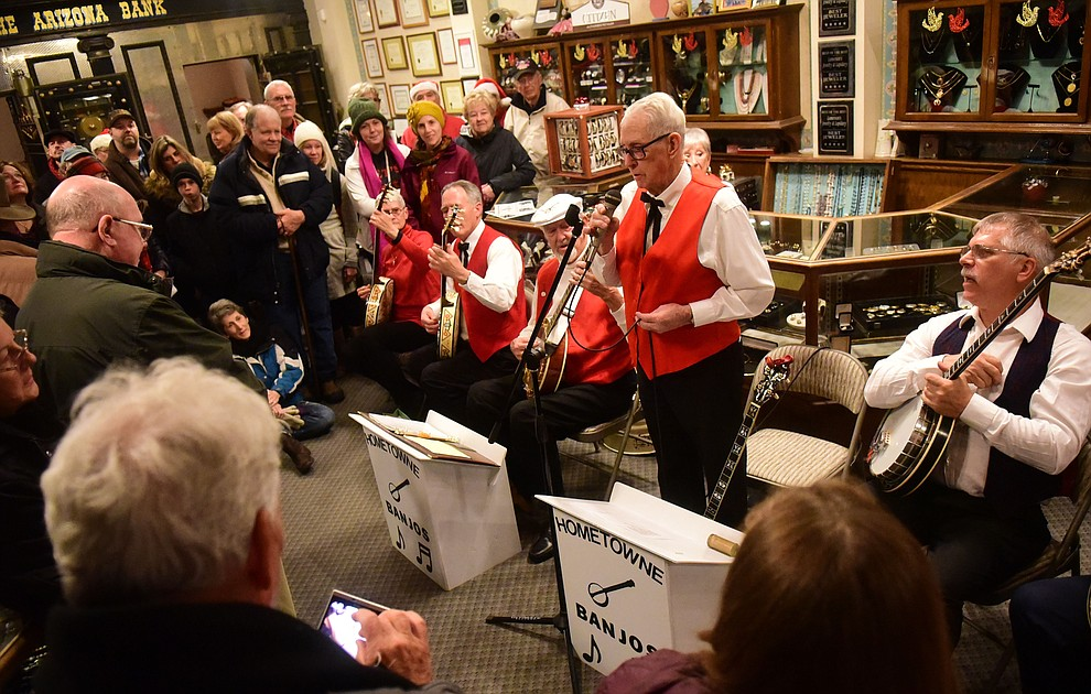 Hometowne Banjoleers perform at Lamerson's Jewelry during the 30th Annual Acker Musical Showcase Friday, Dec. 7, 2018 in downtown Prescott.  (Les Stukenberg/Courier).