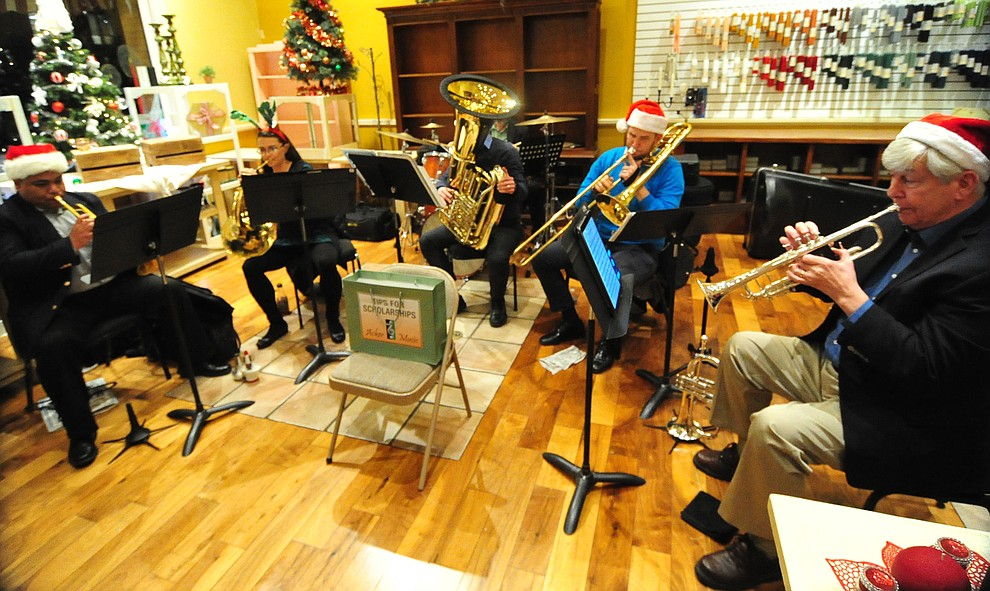 The Yavapai College Brass Quintet perform at Armadilla Wax Works during the 30th Annual Acker Musical Showcase Friday, Dec. 7, 2018 in downtown Prescott.  (Les Stukenberg/Courier).