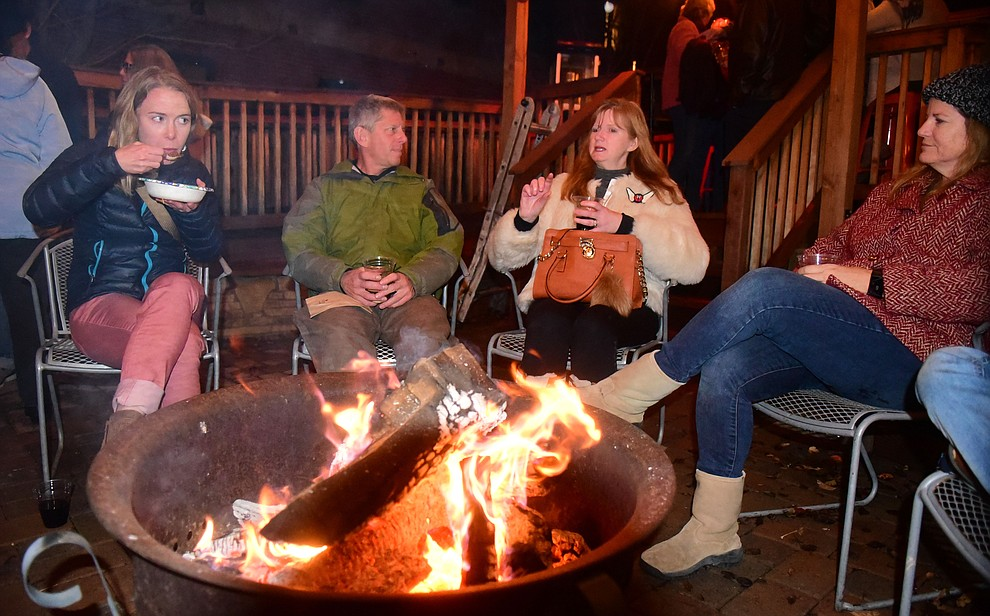 Chlli, libations, good friends and a warm fire at the Barley Hound during the 30th Annual Acker Musical Showcase Friday, Dec. 7, 2018 in downtown Prescott.  (Les Stukenberg/Courier).