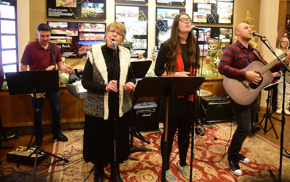 Bethle Hymn perform at Realty executives of Northern Arizona during the 30th Annual Acker Musical Showcase Friday, Dec. 7, 2018 in downtown Prescott.  (Les Stukenberg/Courier).