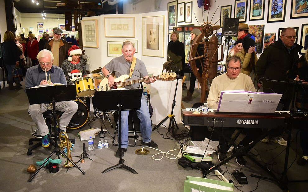 Cool Azul perform at Van Gogh's Ear Gallery during the 30th Annual Acker Musical Showcase Friday, Dec. 7, 2018 in downtown Prescott.  (Les Stukenberg/Courier).