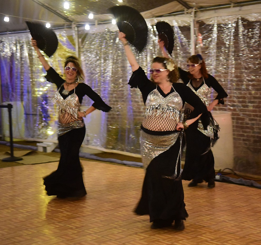 Why Not Bellydance and Friends perform at the Holiday Courtyard during the 30th Annual Acker Musical Showcase Friday, Dec. 7, 2018 in downtown Prescott.  (Les Stukenberg/Courier).