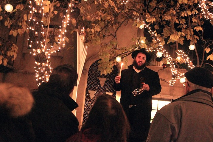 Chabad of Sedona hosted a menorah lighting event to commemorate the first night of Hanukkah Sunday at the Tlaquepaque in Sedona. Friday marks the sixth night. Chabad Rabbi Mendel Kessler recites the three Hanukkah blessings before lighting a giant menorah at Patio Del Norte. VVN/Kelcie Grega