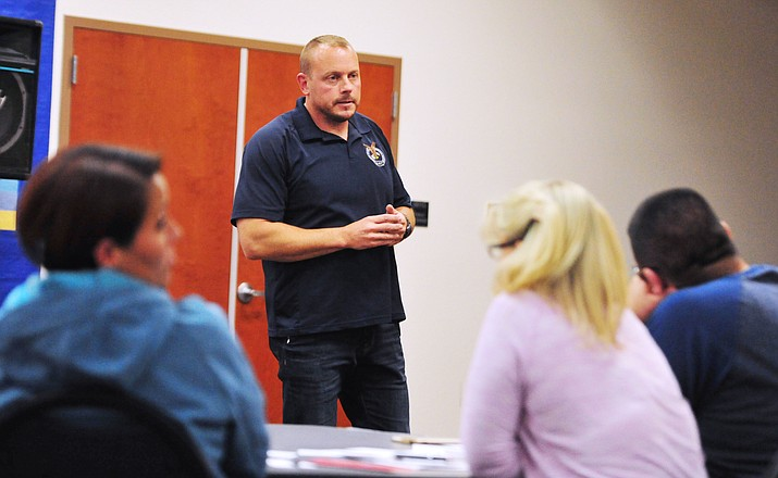 Partners Against Narcotics Trafficing Commander Nate Auvenshine talks about the current trend in drug seizures during a Humboldt Unified School District parent forum in Prescott Valley. (Les Stukenberg/Courier)