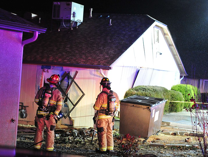 Firefighters with the Central Arizona Fire and Medical Authority inspect a triplex residence along Lakeshore Drive that was reported to have experienced some sort of explosion Thursday night, Dec. 6.
