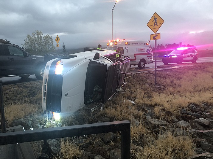 A white work truck rolled after going through a roundabout at the intersection of Willow Lake Road and Highway 89 Friday morning, Dec. 7.