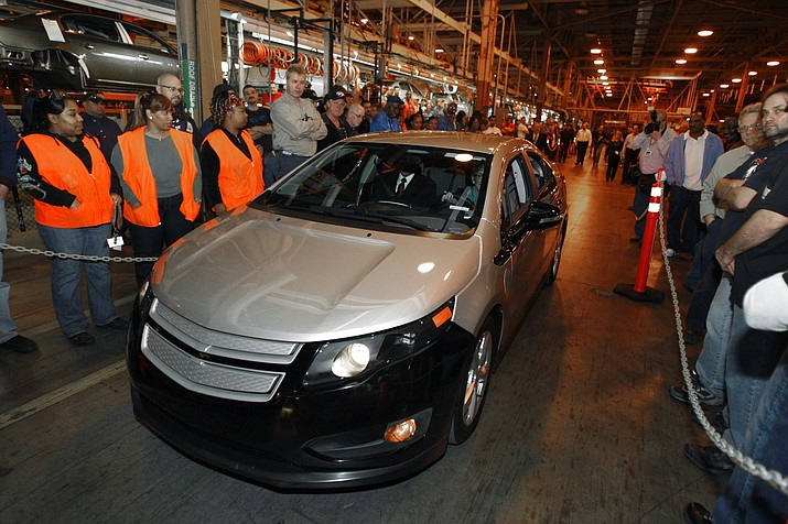 """In a Dec. 7, 2009 file photo, Michigan Gov. Jennifer Granholm drives a pre-production Chevrolet Volt at the Hamtramck Assembly plant in Hamtramck, Mich. GMs' planned shutdown of its Detroit-Hamtramck plant would leave only one auto assembly factory in the city known for """"putting America on wheels,"""" but the closure and job losses are not expected to stall-out Detroit's remarkable comeback following its 2014 bankruptcy exit. GM wants to close four facilities in the United States and one in Canada. (AP Photo/Carlos Osorio)"""