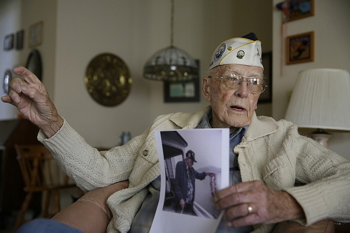 Don Long recalls the 1941 Japanese attack on Hawaii at the same time it took place 77 years ago while sitting in his home Friday, Dec. 7, 2018, in Napa, Calif. (Eric Risberg/AP)