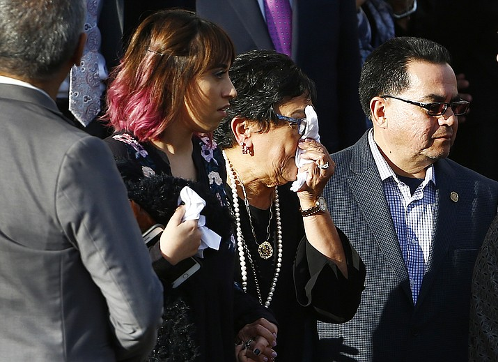 Verma Pastor, middle, wife of former Democratic U.S. Rep. Ed Pastor, wipes away tears outside of St. Francis Xavier Catholic Church after a funeral for her husband Friday, Dec. 7, 2018, in Phoenix. Rep. Pastor was Arizona's first Hispanic member of Congress, spending 23 years in Congress before retiring in 2014. Rep. Pastor passed away last week at the age of 75. (Ross D. Franklin/AP)