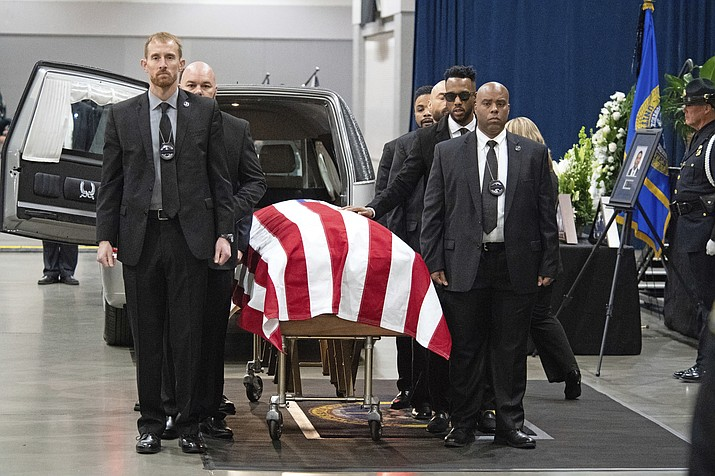 U.S. Marshals escort the casket inside the Tucson Convention Center in Tucson, Ariz., for the Celebration of Life ceremony for fallen U.S. Marshal Deputy Chase White on Friday, Dec. 7, 2018. White was shot and killed while serving an arrest warrant on Nov. 29. (Shane T. McCoy/U.S. Marshals Service via AP)