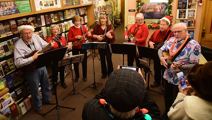 The Prescott Ukulele Guild performs at the Prescott Chamber of Commerce during the 30th Annual Acker Musical Showcase Friday, Dec. 7, 2018 in downtown Prescott.  (Les Stukenberg/Courier)