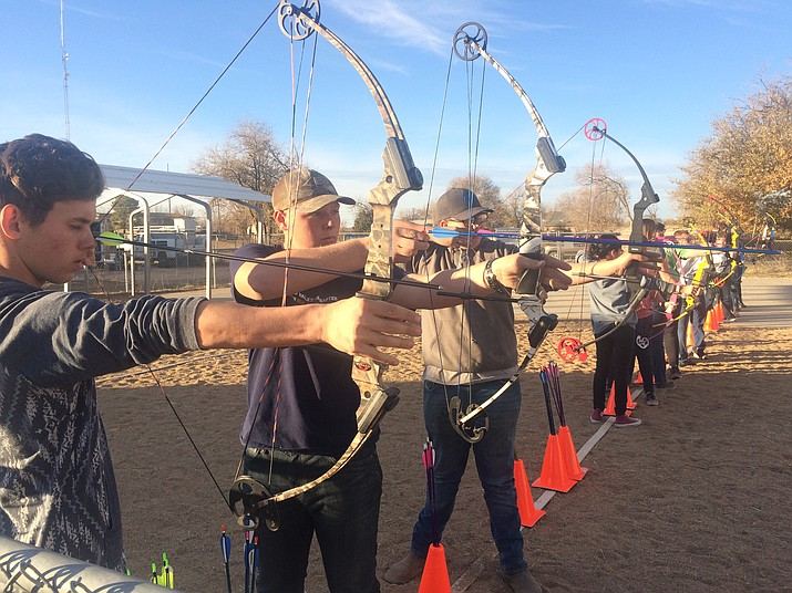 Marshall Carcoba, Kyle Smith, Kevin Short and others on the line and ready to shoot during the Chino Valley High archery team's practice Tuesday. (Jason Wheeler/Courier)