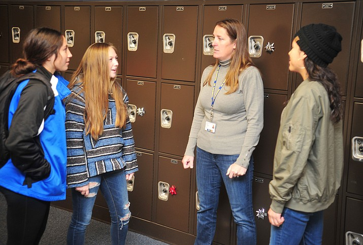 Prescott High School Athletic Director Missy Townsend interacts with student athletes, from left, Rebekah Norris, Janie Rudie and Astri Lopez on Thursday, Dec. 6, 2018, in Prescott. (Les Stukenberg/Courier)