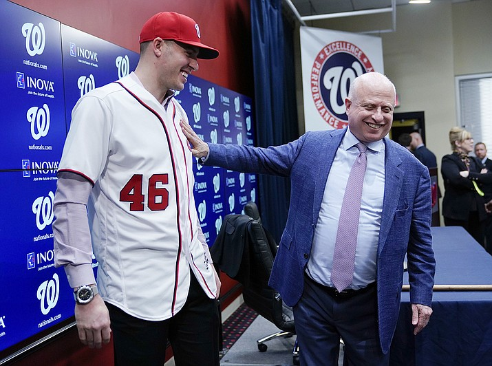 Washington Nationals owner Mark Lerner, right, greets pitcher Patrick Corbin, left, during a news conference at Nationals Park in Washington, Friday, Dec. 7, 2018. (Pablo Martinez Monsivais/AP)