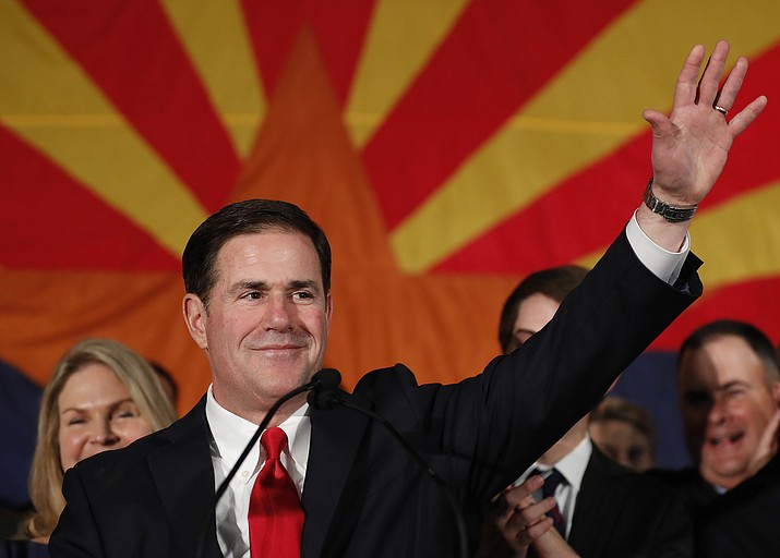 Republican Arizona Gov. Doug Ducey speaks to supporters, Tuesday, Nov. 6, 2018, at an election night party in Scottsdale, Ariz. Incumbent Ducey defeated Democratic challenger David Garcia for his second term. (AP Photo/Matt York)