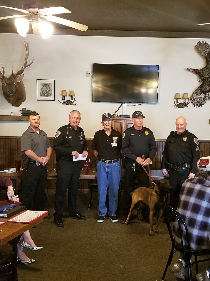 Pictured from left to right: Detective K-9 Handler Adam Parrott, Chief Bob DeVries, Kingman Social Club President Skip Poole, Ofc. Bill Fancher and his K-9 Svende and K9 Supervisor Sergeant Todd Foster
