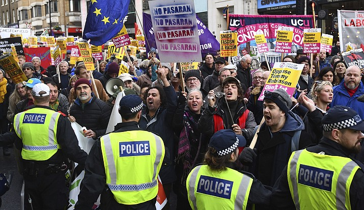 "People take part in an anti-fascist counter-demonstration against the ""Brexit Betrayal Rally"" led by English far-right activist Tommy Robinson who serves as a political adviser to the Leader of the UK Independence Party, UKIP, in central London, Sunday Dec. 9, 2018. Police patrolled the route and separated the two rallies. (Victoria Jones/PA via AP)"