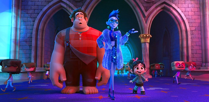 """This image released by Disney shows characters, from left, Ralph, voiced by John C. Reilly, Yess, voiced by Taraji P. Henson and Vanellope von Schweetz, voiced by Sarah Silverman in a scene from """"Ralph Breaks the Internet."""" On a quiet weekend at the box office, """"Ralph Breaks the Internet"""" was No. 1 for the third straight week, while the upcoming DC Comics superhero film """"Aquaman"""" made a huge splash in Chinese theaters. (Disney via AP, File)"""