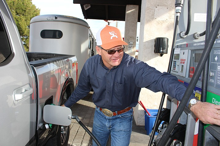 Dusty Reidhead of Show Low selects diesel fuel at $3.29 a gallon Monday at Terrible's on Route 66. Arizona gas prices are trending higher than the national average, according to GasBuddy.com. (Photo by Hubble Ray Smith/Daily Miner)