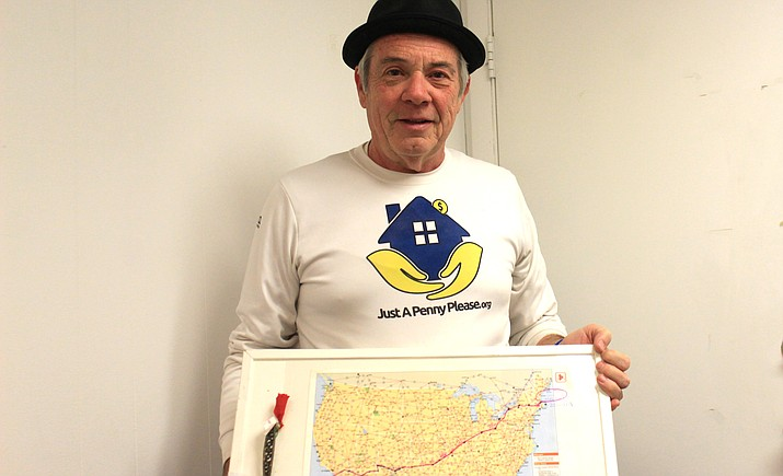 Michael Capozzoli displays a map of his route across the country. He is raising money to build a shelter for survivors of domestic violence and abuse. VVN/Kelcie Grega