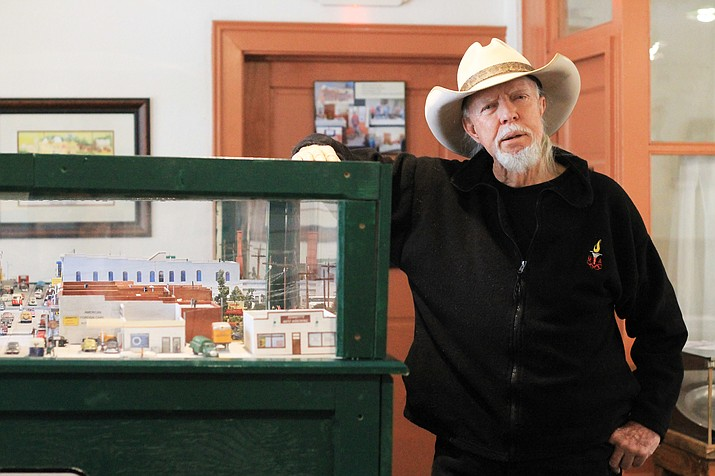 Jim Garvey stands next to his replica of historic Route 66 in Williams. Garvey spent the past three years working on the project that now resides in the history room at the Williams Visitor Center. (Wendy Howell/WGCN)