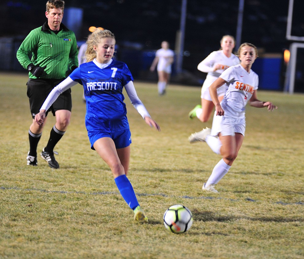 Prescott's Lily Jensen drives the ball upfield as the Badgers take on Seton Catholic Sentinels  Tuesday, Dec. 11, 2018 in Prescott. (Les Stukenberg/Courier).